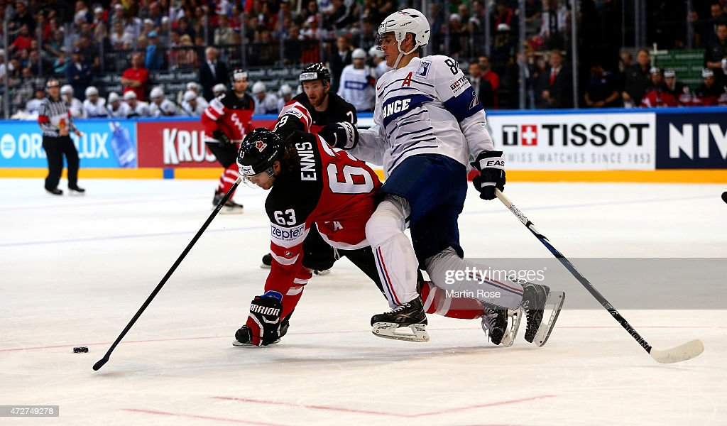 Kevin Hecquefeuille (R) of France and Tyler Ennis (L) of Canada battle for the puck during the IIHF World Championship group A match between France and Canada at o2 Arena on May 9, 2015 in Prague, Czech Republic.