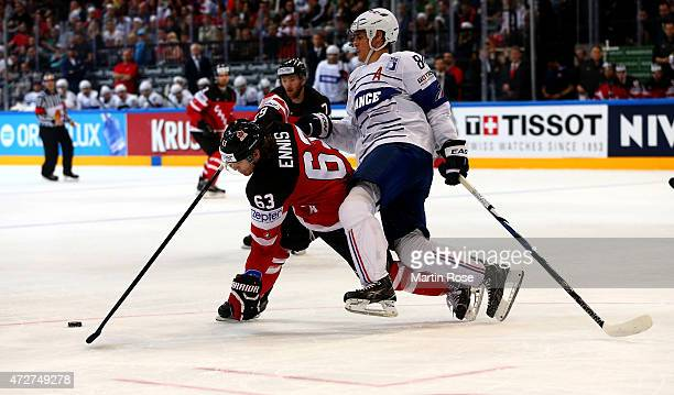 Kevin Hecquefeuille of France and Tyler Ennis of Canada battle for the puck during the IIHF World Championship group A match between France and...