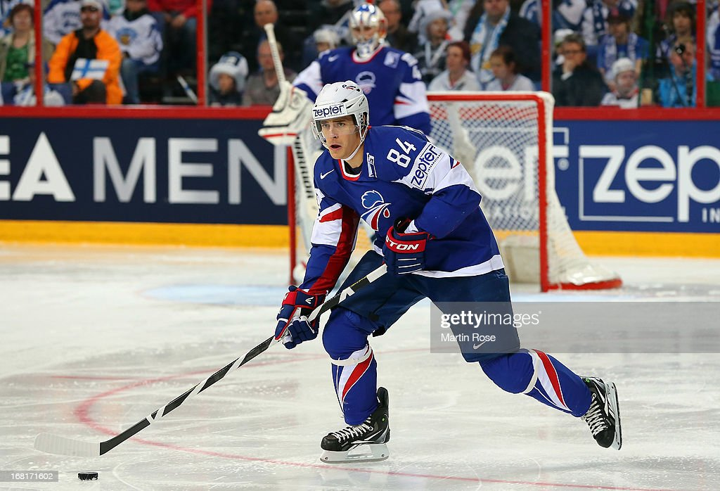 Kevin Hecquefeuille of France skates with the puck during the IIHF World Championship group H match between Finland and France at Hartwall Areena on May 6, 2013 in Helsinki, Finland.