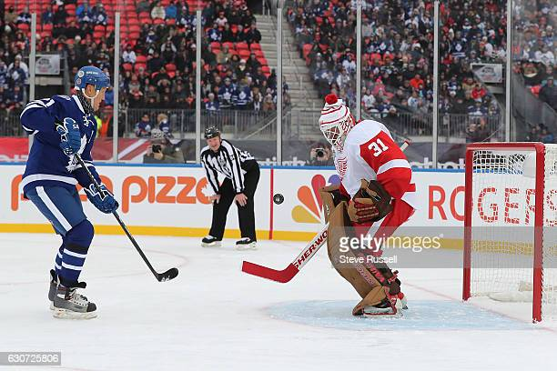 TORONTO ON DECEMBER 31 Kevin Hodson stops Borje Salming on a penalty shot as the Toronto Maple Leafs alumni play the Detroit Red Wings alumni on the...