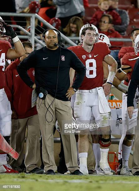 Kevin Hogan and head coach David Shaw of the Stanford Cardinal stand on the sideline after the Cardinal fumbles the ball in the fourth quarter...