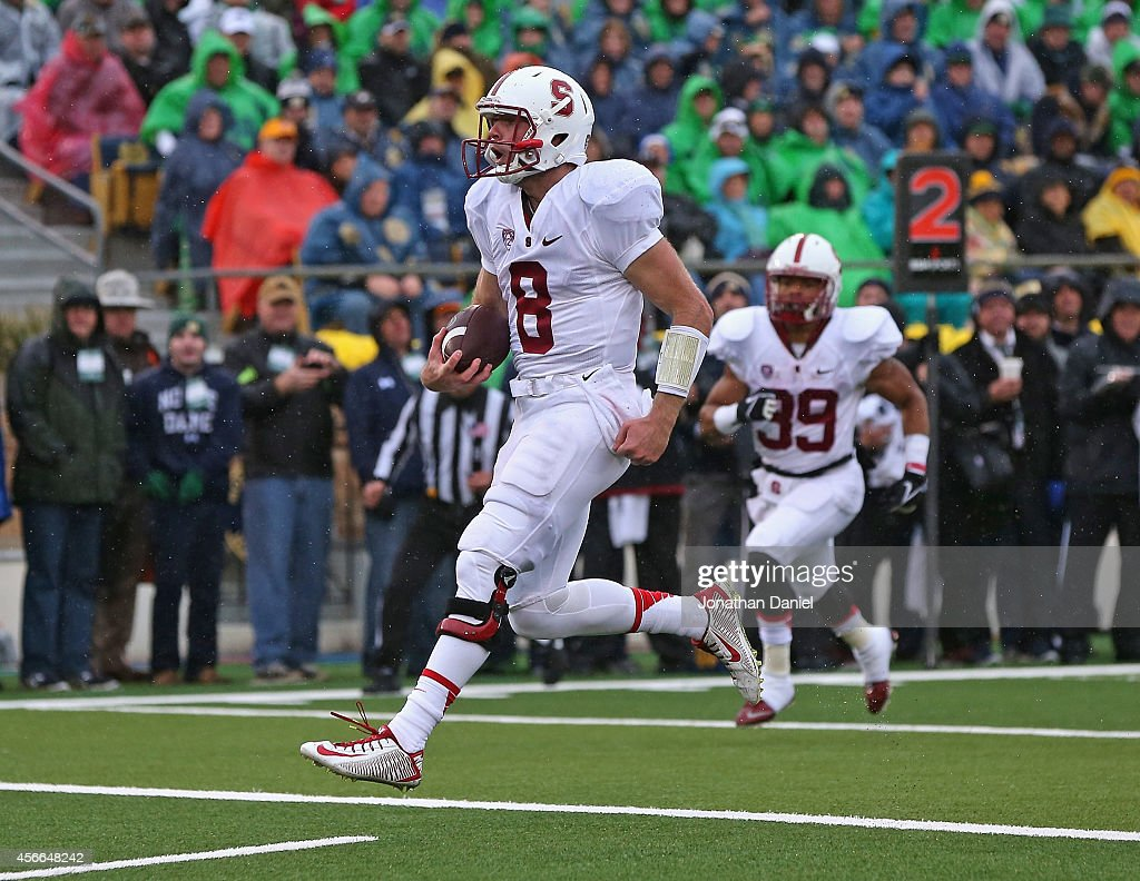 Kevin Hogan of the Standford Cardinal runs into the end zone for a touchdown against the Notre Dame Fighting Irish at Notre Dame Stadium on October 4...