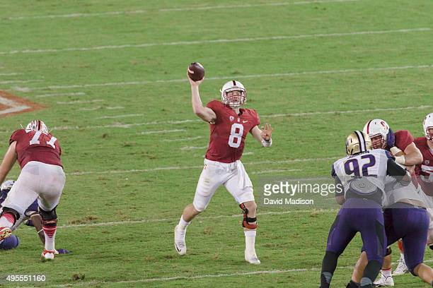 Kevin Hogan of the Stanford Cardinal attempts a pass during a PAC12 football game against the University of Washington Huskies played on October 24...