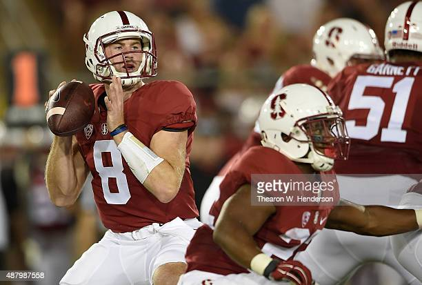 Kevin Hogan of the Stanford Cardinal drops back to pass against the UCF Knights in the first quarter at Stanford Stadium on September 12 2015 in Palo...
