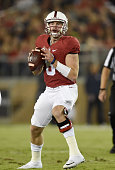 Kevin Hogan of the Stanford Cardinal drops back to pass against the Arizona Wildcats in the first quarter of a NCAA football game at Stanford Stadium...