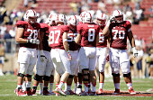 Kevin Hogan of the Stanford Cardinal huddles his team together during their game against the UC Davis Aggies at Stanford Stadium on August 30 2014 in...