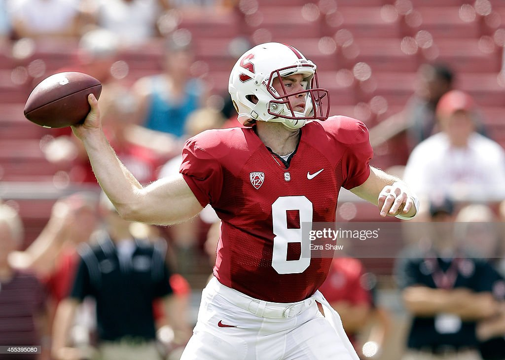 Kevin Hogan of the Stanford Cardinal passes the ball against the Army Black Knights at Stanford Stadium on September 13 2014 in Palo Alto California