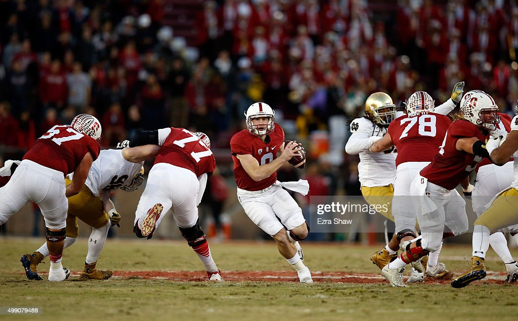 Kevin Hogan of the Stanford Cardinal runs with the ball against the Notre Dame Fighting Irish at Stanford Stadium on November 28 2015 in Palo Alto...