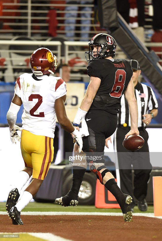 Kevin Hogan #8 of the Stanford Cardinal scores a touchdown in front of Adoree' Jackson #2 of the USC Trojans during the second quarter of the NCAA Pac-12 Championship game at Levi's Stadium on December 5, 2015 in Santa Clara, California.