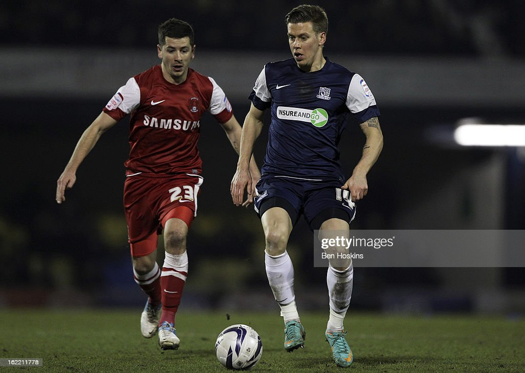 Kevin Hurst of Southend holds off pressure from Scott Cuthbert of Leyton Orient during the Johnstone's Paint Trophy Southern Section Final match between Southend United and Leyton Orient at the Roots Hall Stadium on February 20, 2013 in Southend, England.