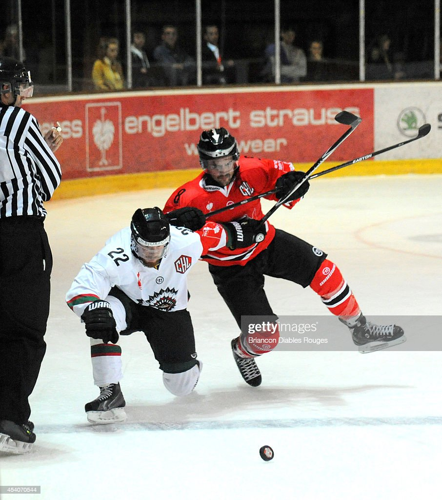 #8 Kevin Igier of Briancon Diables Rouges battles with Robin Figren of Frolunda Gothenburg during the Champions Hockey League group stage game between Briancon Diables Rouges and Frolunda Gothenburg on August 23, 2014 in Briancon, France.