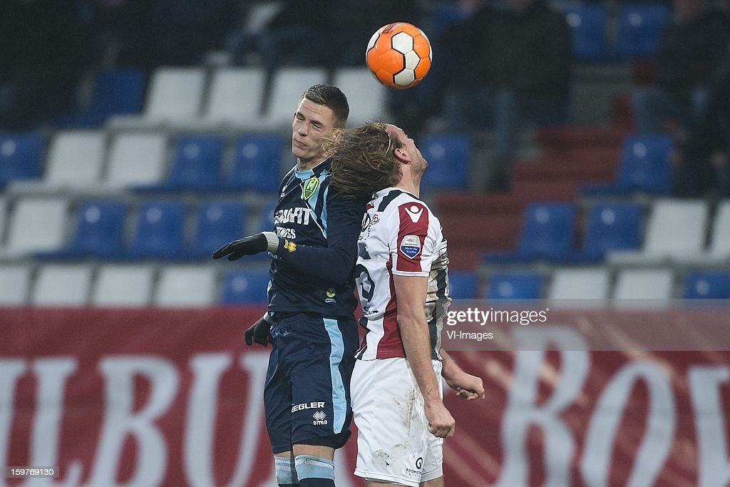 Kevin Jansen of ADO Den Haag, Niek Vossebelt of Willem II during the Dutch Eredivise match between Willem II and ADO Den Haag at the Koning Willem II Stadium on January 20, 2013 in Tilburg, The Netherlands.