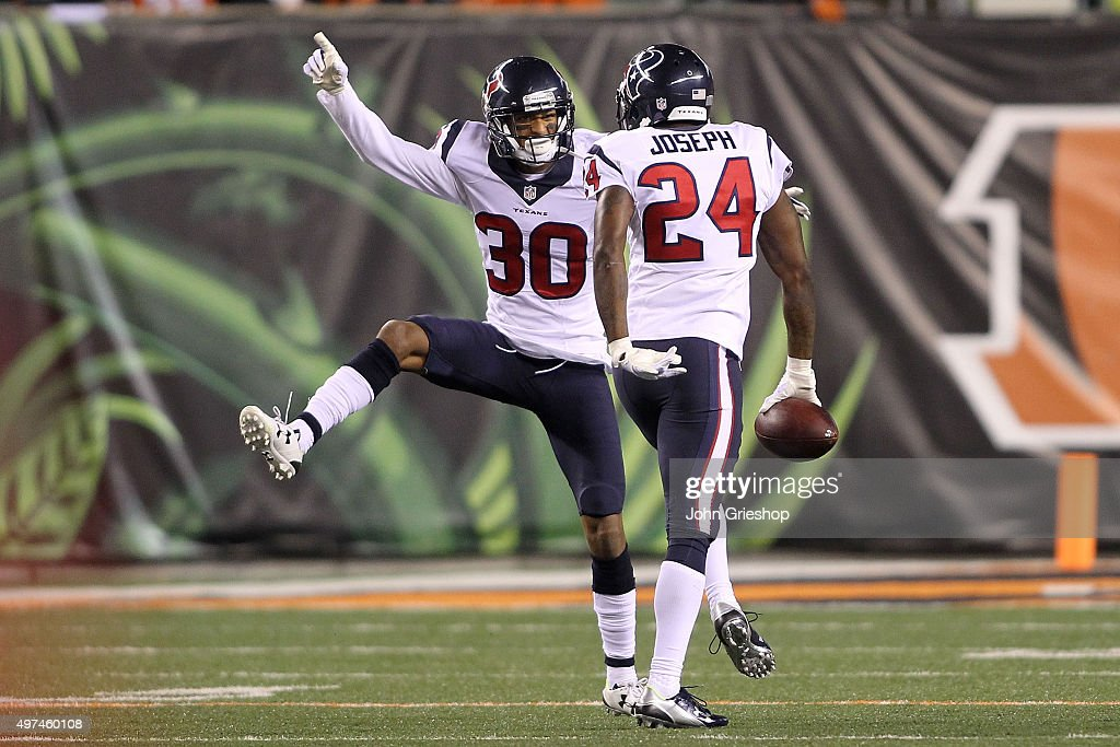 Kevin Johnson of the Houston Texans congratulates Johnathan Joseph of the Houston Texans after intercepting a pass during the third quarter of the...