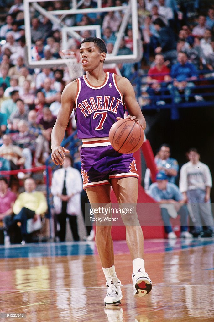 Kevin Johnson of the Phoenix Suns dribbles against the Sacramento Kings circa 1989 at Arco Arena in Sacramento California NOTE TO USER User expressly...
