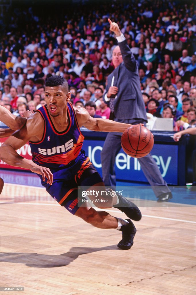 Kevin Johnson of the Phoenix Suns dribbles against the Sacramento Kings circa 1993 at Arco Arena in Sacramento California NOTE TO USER User expressly...