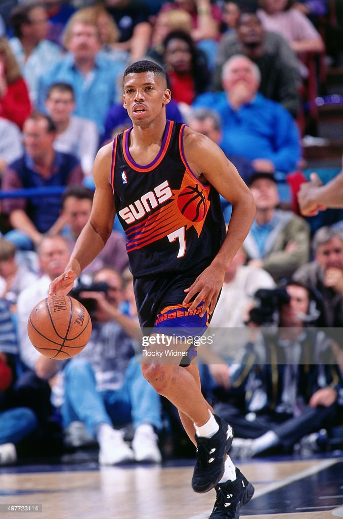 Kevin Johnson of the Phoenix Suns dribbles against the Sacramento Kings circa 1996 at Arco Arena in Sacramento California NOTE TO USER User expressly...