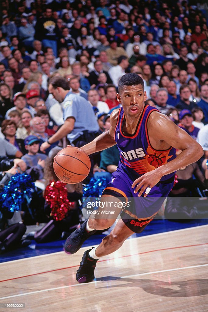 Kevin Johnson of the Phoenix Suns drives against the Sacramento Kings circa 1993 at Arco Arena in Sacramento California NOTE TO USER User expressly...
