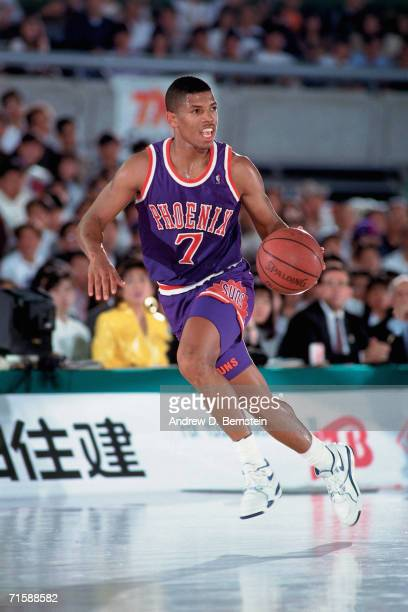 Kevin Johnson of the Phoenix Suns drives up court against the Utah Jazz during the 1990 NBA Opening Games played November 2 1990 at the Tokyo...