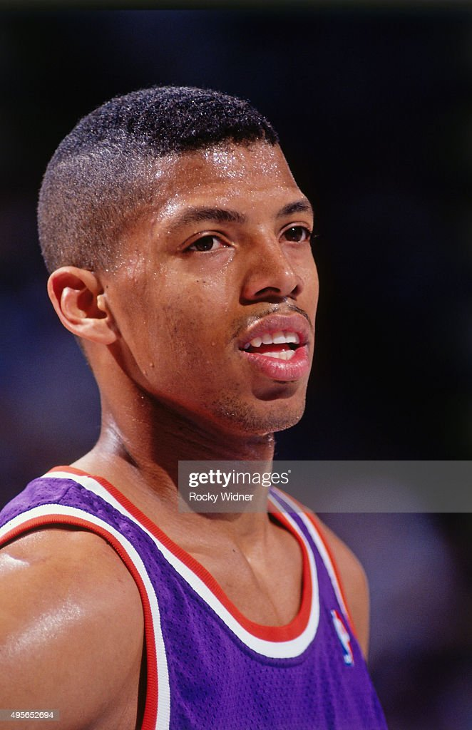 Kevin Johnson of the Phoenix Suns looks on against the Sacramento Kings circa 1991 at Arco Arena in Sacramento California NOTE TO USER User expressly...