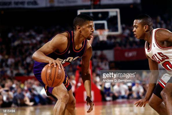 Kevin Johnson of the Phoenix Suns looks to make a play against the Chicago Bulls during Game Six of the 1993 NBA Championship Finals at America West...