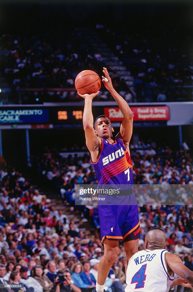 Kevin Johnson of the Phoenix Suns shoots against the Sacramento Kings circa 1993 at Arco Arena in Sacramento California NOTE TO USER User expressly...