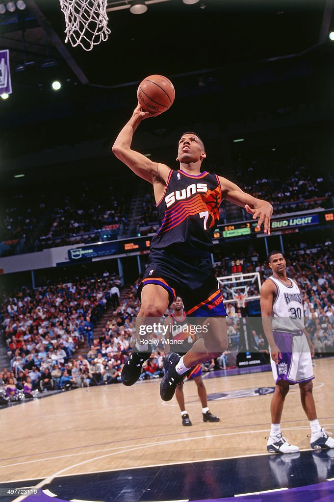 Kevin Johnson of the Phoenix Suns shoots against the Sacramento Kings circa 1996 at Arco Arena in Sacramento California NOTE TO USER User expressly...