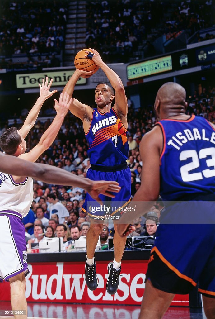 Kevin Johnson of the Phoenix Suns shoots against the Sacramento Kings circa 1997 at Arco Arena in Sacramento California NOTE TO USER User expressly...
