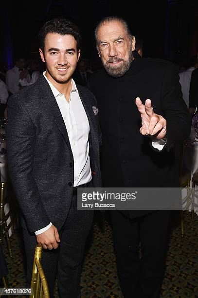 Kevin Jonas and CoFounder Chairman and CEO of John Paul Mitchell Systems and CoFounder of Patron Tequila and Spirits John Paul DeJoria attend the TJ...