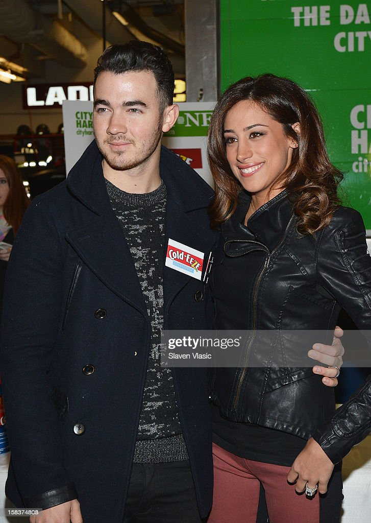 Kevin Jonas and Danielle Jonas attend the Kevin Jonas, Danielle Jonas and City Harvest Holiday Season Food Drive at FDNY Station - Lexington & 3rd on December 14, 2012 in New York City.
