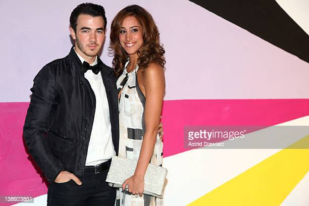 Kevin Jonas and Danielle Jonas pose on the runway at the Alice Olivia Fall 2012 Presentation during MercedesBenz Fashion Week at Center 548 on...