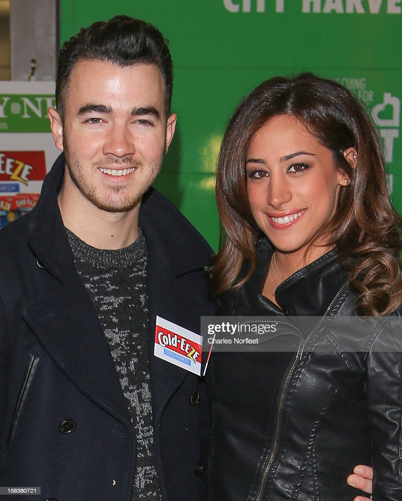 <a gi-track='captionPersonalityLinkClicked' href=/galleries/search?phrase=Kevin+Jonas&family=editorial&specificpeople=709547 ng-click='$event.stopPropagation()'>Kevin Jonas</a> and his wife Danielle Jonas attend the City Harvest Holiday Season Food Drive at FDNY Station - Lexington & 3rd on December 14, 2012 in New York City.