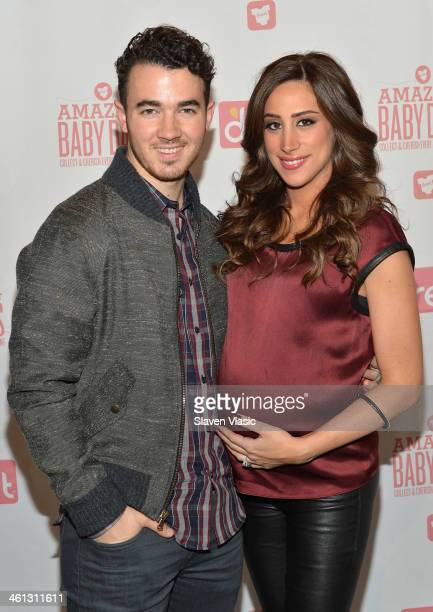 Kevin Jonas and wife Danielle Jonas attend the 'Amazing Baby Days' app launch event at Path 1 Communications on January 7 2014 in New York City