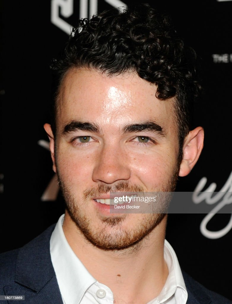 Kevin Jonas arrives at XS The Nightclub at Encore Las Vegas to celebrates his brother, Nick's, 21st birthday on September 16, 2013 in Las Vegas, Nevada.