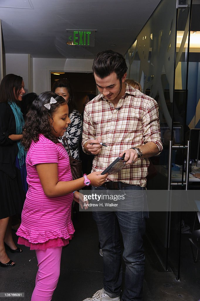 <a gi-track='captionPersonalityLinkClicked' href=/galleries/search?phrase=Kevin+Jonas&family=editorial&specificpeople=709547 ng-click='$event.stopPropagation()'>Kevin Jonas</a> attends the unveiling of the AOL media room at the Roanld McDonald House on October 7, 2001 in New York City.
