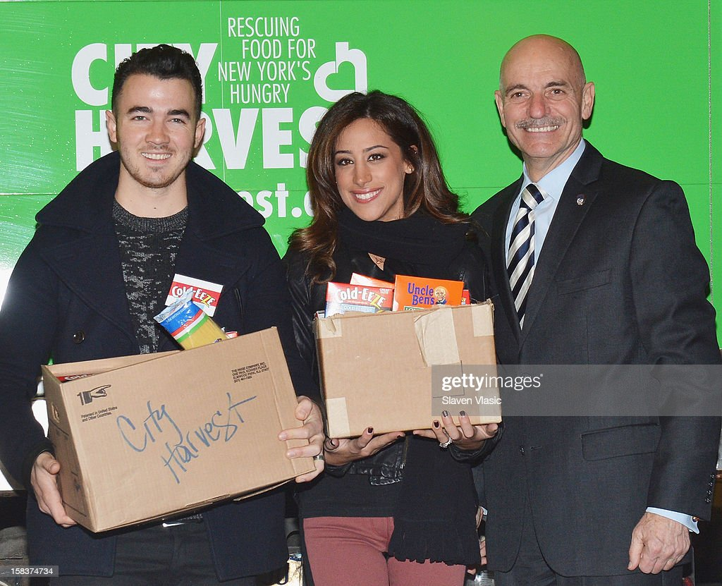 <a gi-track='captionPersonalityLinkClicked' href=/galleries/search?phrase=Kevin+Jonas&family=editorial&specificpeople=709547 ng-click='$event.stopPropagation()'>Kevin Jonas</a>, Danielle Jonas and NYC Fire Commissioner Salvatore J. Cassano attend the <a gi-track='captionPersonalityLinkClicked' href=/galleries/search?phrase=Kevin+Jonas&family=editorial&specificpeople=709547 ng-click='$event.stopPropagation()'>Kevin Jonas</a>, Danielle Jonas and City Harvest Holiday Season Food Drive at FDNY Station - Lexington & 3rd on December 14, 2012 in New York City.