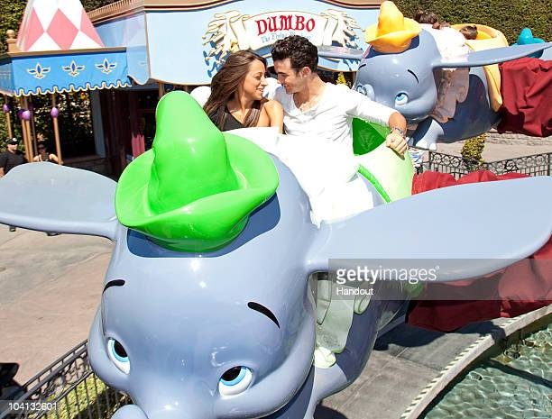 Kevin Jonas eldest of the musical Jonas Brothers took his wife Danielle for a ride on Dumbo the Flying Elephant at Disneyland on September 15 2010 in...