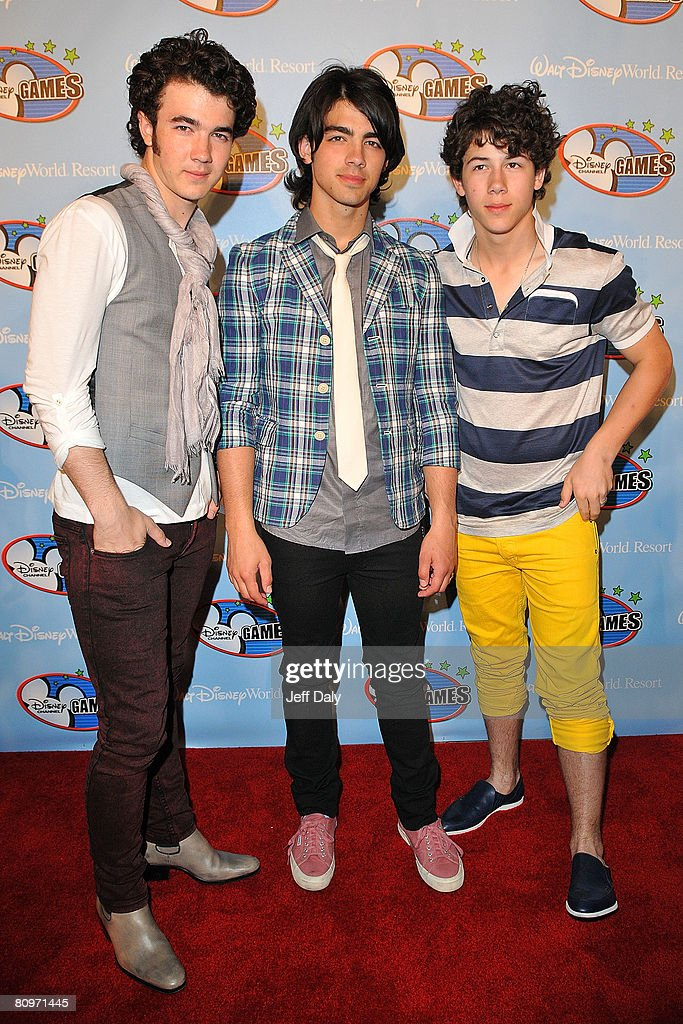 Kevin Jonas Joe Jonas and Nick Jonas of the Jonas Brothers appear on the red carpet for the 2008 Disney Channel Games May 2 2008 at Epcot at Walt...