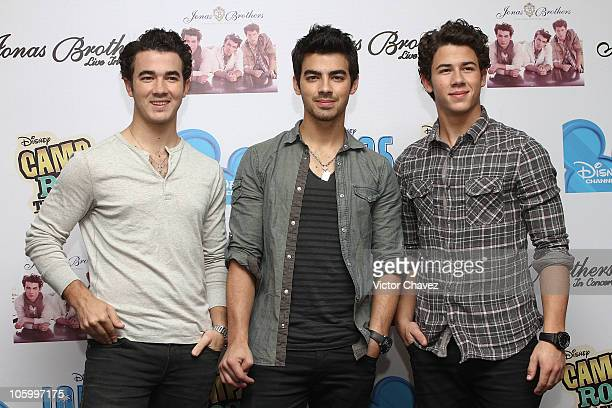 Kevin Jonas Joe Jonas and Nick Jonas of The Jonas Brothers pose to photographers during a press conference to promote a concert and the movie 'Camp...