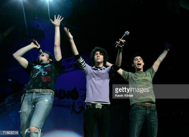 Kevin Jonas Nicholas Jonas and Joseph Jonas of The Jonas Brothers introduce the band Everlife at the Radio Disney Totally 10 Birthday Concert held at...