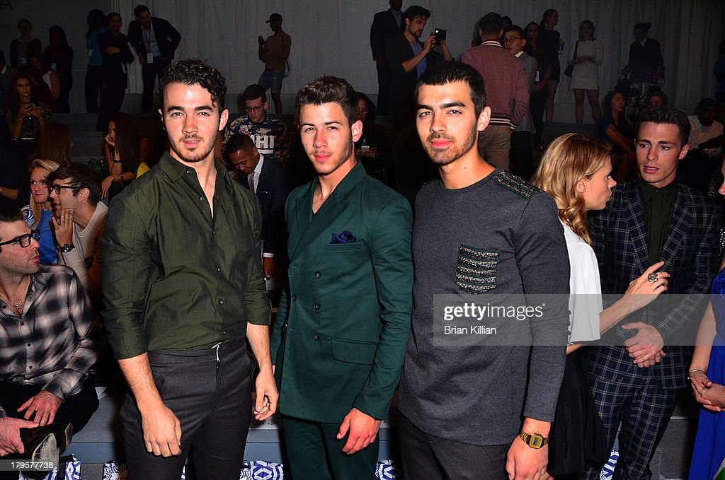 <a gi-track='captionPersonalityLinkClicked' href=/galleries/search?phrase=Kevin+Jonas&family=editorial&specificpeople=709547 ng-click='$event.stopPropagation()'>Kevin Jonas</a>, <a gi-track='captionPersonalityLinkClicked' href=/galleries/search?phrase=Nick+Jonas&family=editorial&specificpeople=842713 ng-click='$event.stopPropagation()'>Nick Jonas</a> and <a gi-track='captionPersonalityLinkClicked' href=/galleries/search?phrase=Joe+Jonas&family=editorial&specificpeople=842712 ng-click='$event.stopPropagation()'>Joe Jonas</a>, aka The Jonas Brothers, attend the Richard Chai -- Love & Richard Chai Men's show during Spring 2014 Mercedes-Benz Fashion Week at The Stage at Lincoln Center on September 5, 2013 in New York City.