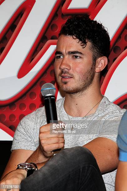 Kevin Jonas of The Jonas Brothers is interviewed in the KISSFM 'CocaCola Lounge' in Chicago Illinois on JULY 10 2013