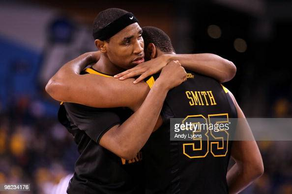 Kevin Jones and Wellington Smith of the West Virginia Mountaineers console each other after they lost 7857 against the Duke Blue Devils during the...