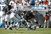 Kevin Jones of the Chicago Bears runs through the tackle by Julius Peppers of the Carolina Panthers during a game on September 14 2008 at the Bank of...