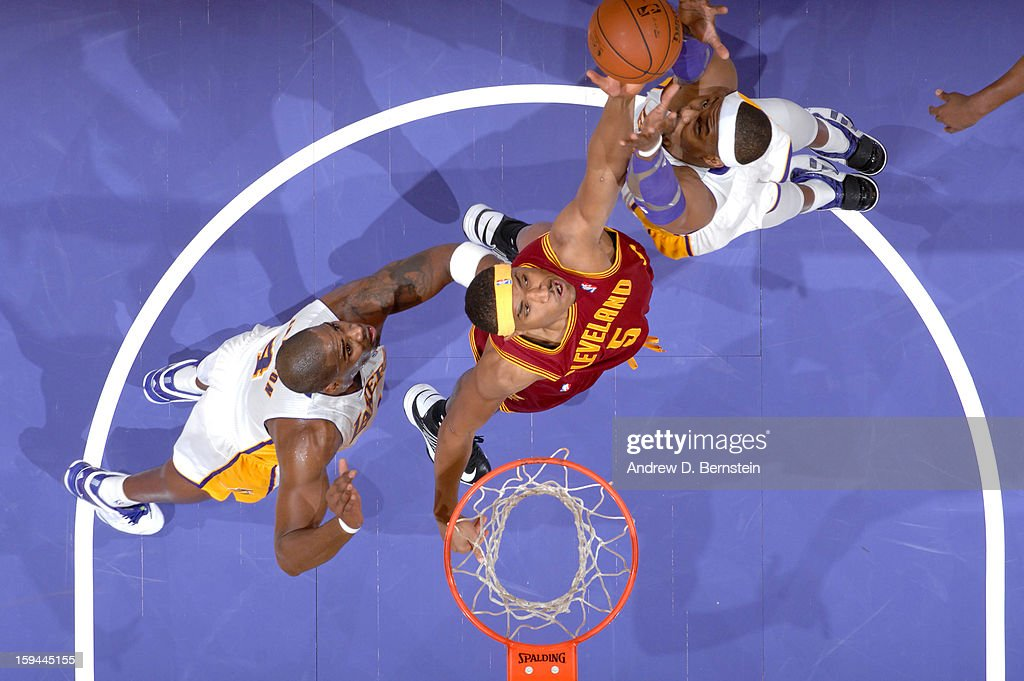 Kevin Jones #5 of the Cleveland Cavaliers reaches for a rebound against Antawn Jamison #4 and Dwight Howard #12 of the Los Angeles Lakers at Staples Center on January 13, 2013 in Los Angeles, California.