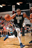 Kevin Jones of the Milwaukee Bucks drives against the Phoenix Suns during the 2015 NBA Las Vegas Summer League game on July 16 2015 at The Cox...