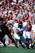 Kevin Jones of the Virginia Tech Hokies runs with the ball against the Texas AM Aggies in College Station Texas on September 21 2002
