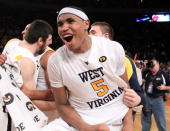 Kevin Jones of the West Virginia Mountaineers celebrates after defeating the Georgetown Hoyas during the championship of the 2010 NCAA Big East...