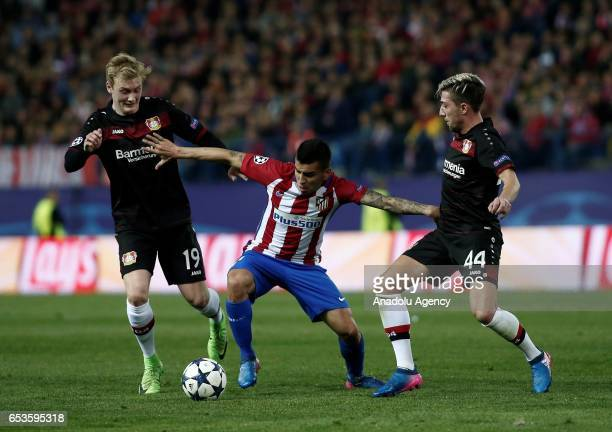 Kevin Kampl and Julian Brandt of Bayer 04 Leverkusen in action against Angel Correa of Atletico Madrid during the UEFA Champions League Round of 16...