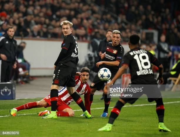 Kevin Kampl and Julian Brandt of Bayer Leverkusen in action against Sime Vrsaljko of Atletico Madrid during the UEFA Champions League round of...