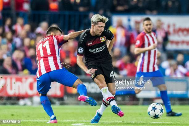Kevin Kampl of Bayer 04 Leverkusen battles for the ball with Angel Correa of Atletico de Madrid during their 201617 UEFA Champions League Round of 16...